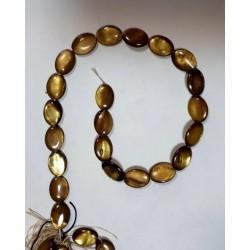 Золотистый овальный камень на нитке 22шт цена за нитку